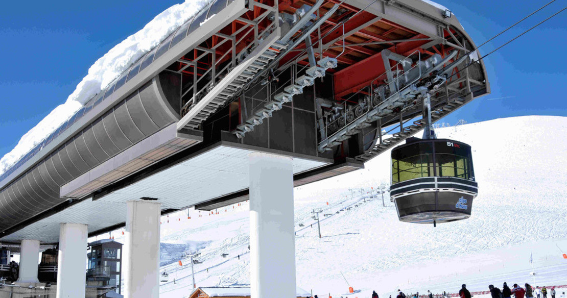 Luxury chalets in Alpe dHuez - the modern Troncon gondola from the Gognet area of the resort
